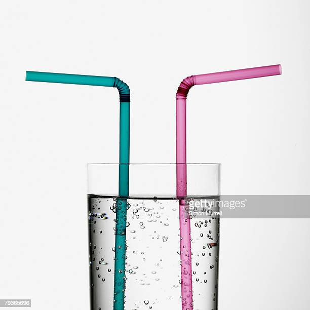 Beverage indoors with two straws