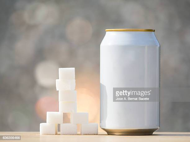 Beverage  refreshment tinned, and his equivalent in lumps of sugar cubes ,  illuminated by the light of the Sun