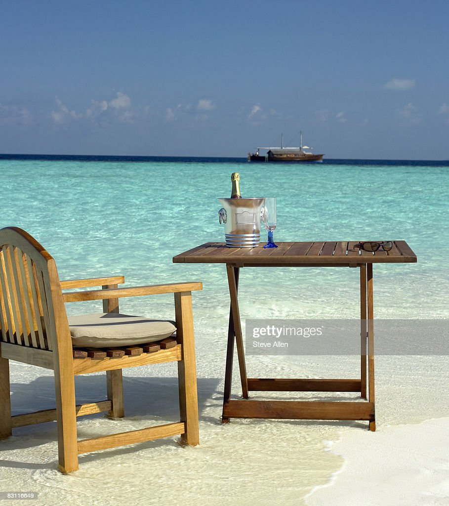 Beverage Table And Chair On The Beach