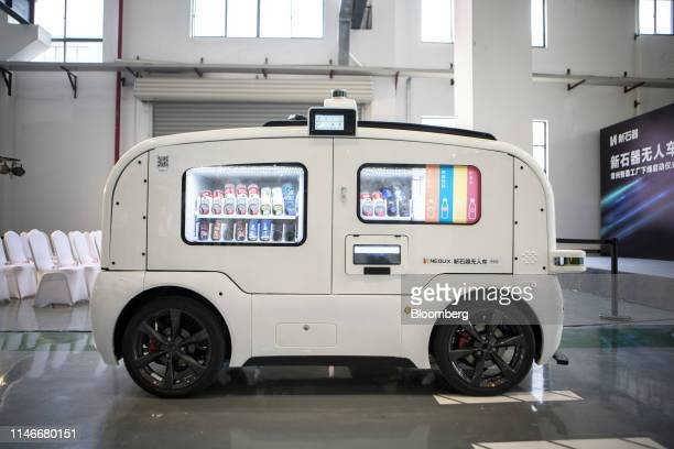 Beverages sit inside a Neolix autonomous vendingmachine vehicle during a launch event at the company's facility in Changzhou Jiangsu province China...