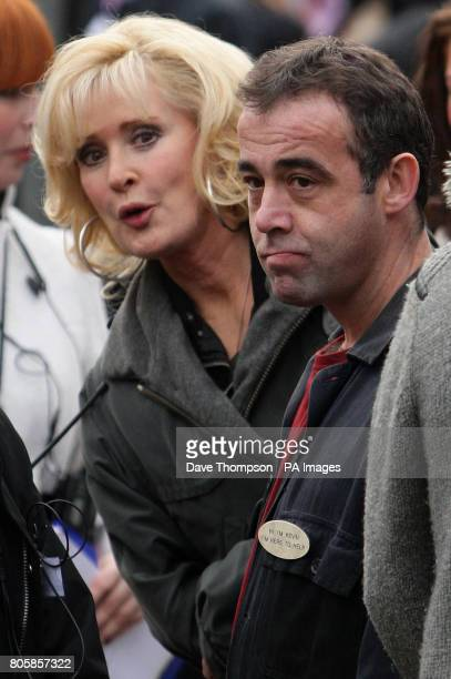 Beverley Callard and Michael Le Vell wait to greet the Duchess of Cornwall during her visit to the set of Coronation Street in Manchester