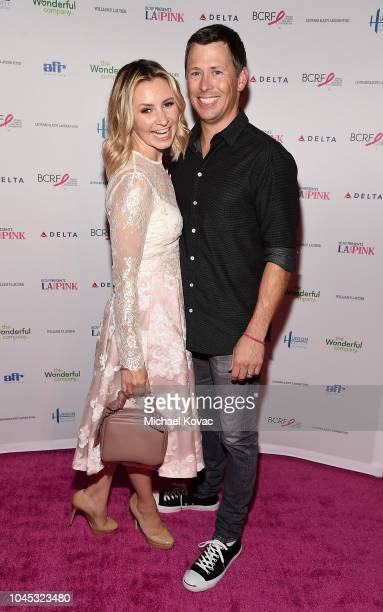 Beverley Mitchell and Michael Cameron attend BCRF Presents LA GOES PINK on October 3 2018 in Beverly Hills California