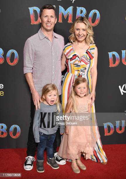 Beverley Mitchell and Michael Cameron with kids Kenzie Cameron and Hutton Michael Cameron attend the premiere of Disney's Dumbo at El Capitan Theatre...