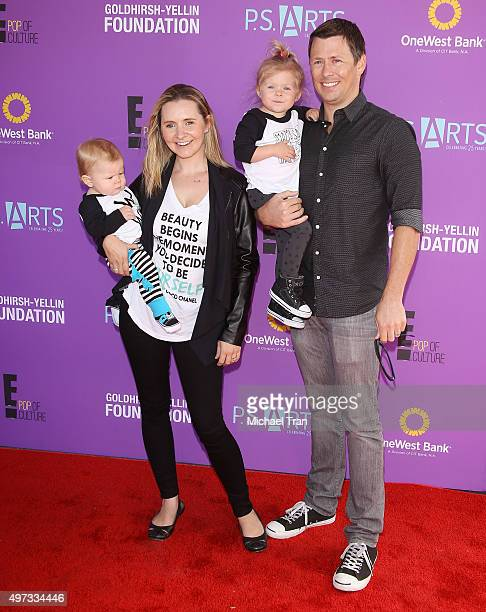 Beverley Mitchell with her husband Michael Cameron and their children arrive at the PS ARTS presents Express Yourself 2015 held at Barker Hangar on...