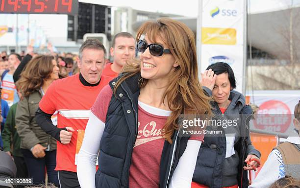 Beverley Turner attends a photocall ahead of the Sainsbury's Sport Relief challenge at Queen Elizabeth Olympic Park on March 23 2014 in London England