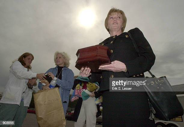 Beverly Crawford of Signal Mountain TN holds an urn which she thought contained the ashes of her husband Robert H Crawford Jr outside the Walker...