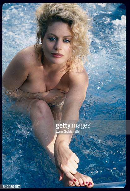 Beverly D'Angelo in a blue water