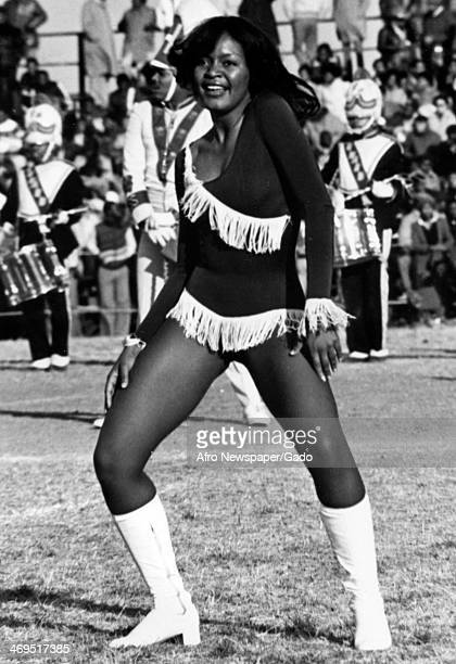 Beverly Durra member of the Howard University's Soul Steppers performs at halftime during a football game Washington DC 1980