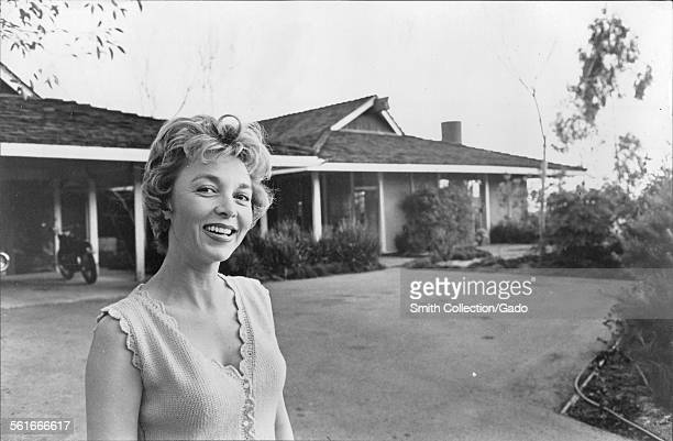 Beverly Garland posing with her house on Mulholland Drive in Hollywood Hills Hollywood California 1965