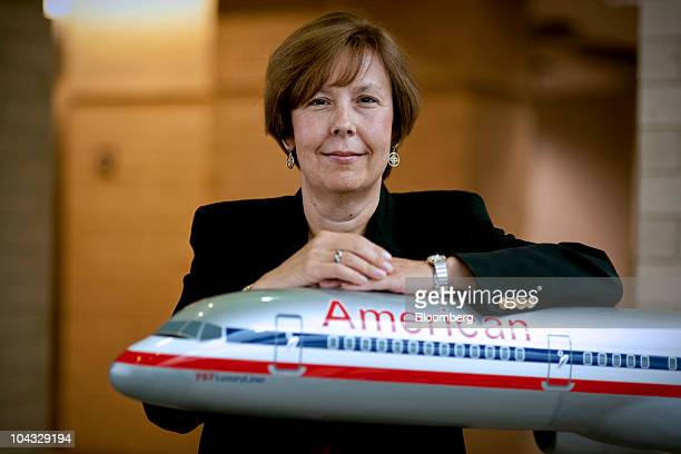 Beverly Goulet treasurer and vice president of corporate development for American Airlines parent AMR Corp stands for a photo with a model Boeing...