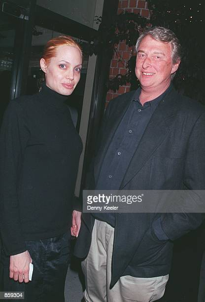 Beverly Hills CA Angelina Jolie and Mike Nichols outside Mr Chow's restaurant Photo by David Keeler/Online USA Inc