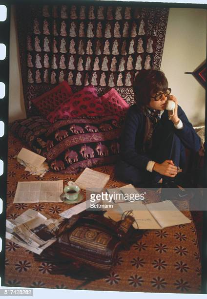 In her Beverly Hills CA home actress Jane Fonda sits on her bed amid a collage of Indian print pillows bedspreads and wall hanging as she makes a...