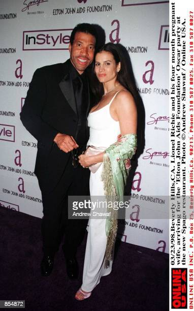 Beverly Hills CA Lionel Richie and his four month pregnant wife Diane Alexander arriving for the ''Elton John Aids Foundation'' Oscar party at the...