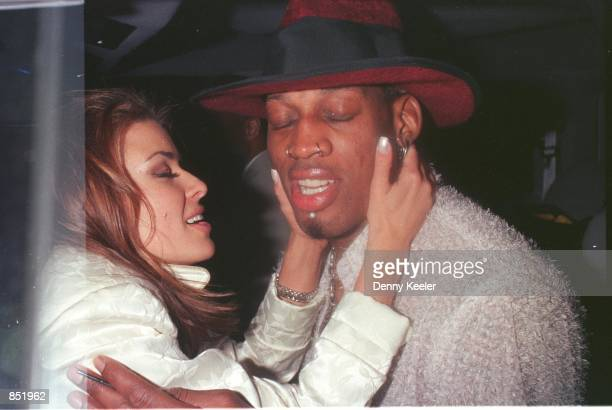 Beverly Hills, CA. New Laker Dennis Rodman celebrates his first winning game out on the town at GOODBAR with wife Carmen Electra.