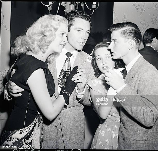 6/1/1946 Beverly Hills CA Roddy MacDowell young star of 20th Century Fox andhis pert and pretty partner Jane Powell stop to chat with Marilyn Maxwell...