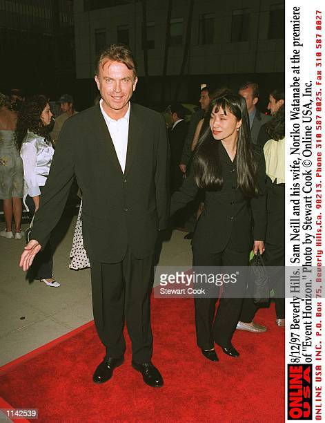Beverly Hills CA Sam Neill and his wife Noriko Watanabe at the premiere of Event Horizon