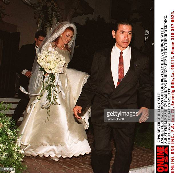 Beverly Hills Calif Angie Everhart runs out of a Beverly Hills church after her marriage to Ashley Hamilton her new husband is barely visible behind...