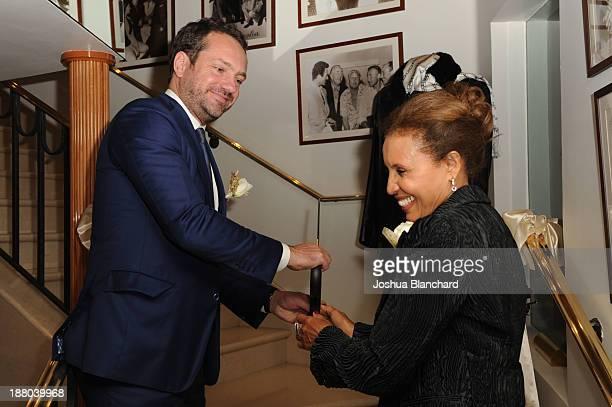 Beverly Hills Chamber of Commerce Alexander Stettinski and Battaglia Owner Fauzia Abdu cut the ribbon celebrating Battaglia's 50th Anniversary of...