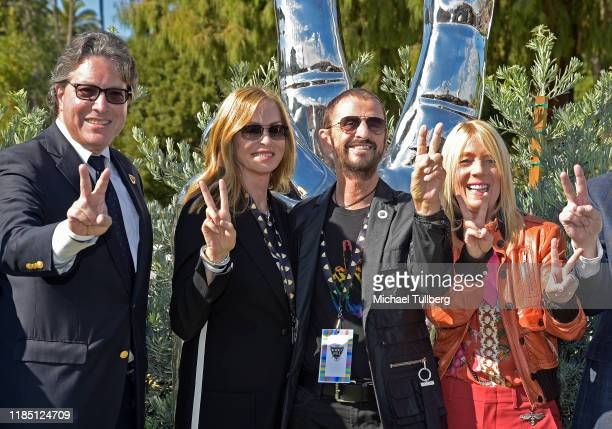 Beverly Hills Mayor John Mirisch Barbara Bach musician Ringo Starr and guest pose at a public art dedication for Starr's donated sculpture Peace and...
