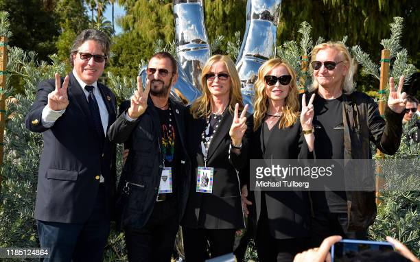 Beverly Hills Mayor John Mirisch Barbara Bach musician Ringo Starr Marjorie Bach and musician Joe Walsh pose at a public art dedication for Starr's...