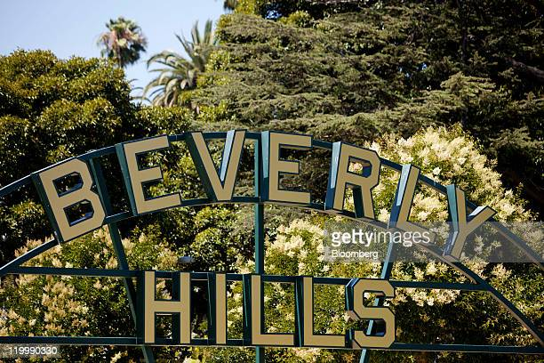 A Beverly Hills sign stands on Santa Monica Boulevard in Beverly Hills California US on Tuesday July 26 2011 Global sales of luxury goods may rise 8...