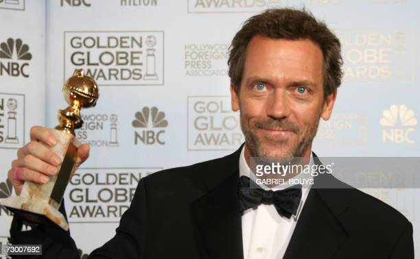 Hugh Laurie poses with the award for Best Actor in a Television SeriesDrama for his role in House 15 January 2007 at the 64th Annual Golden Globe...