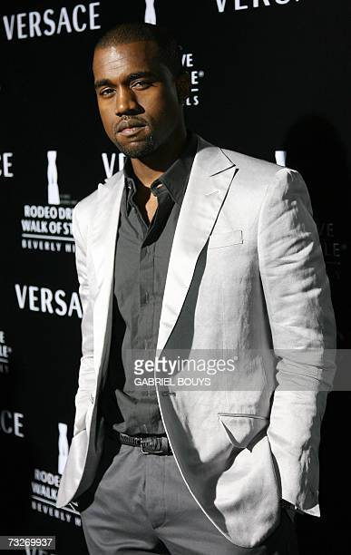 Singer Kanye West arrives for the Rodeo Drive Walk of Style Award 08 February 2007 in Beverly Hills California Gianni Versace and his sister...