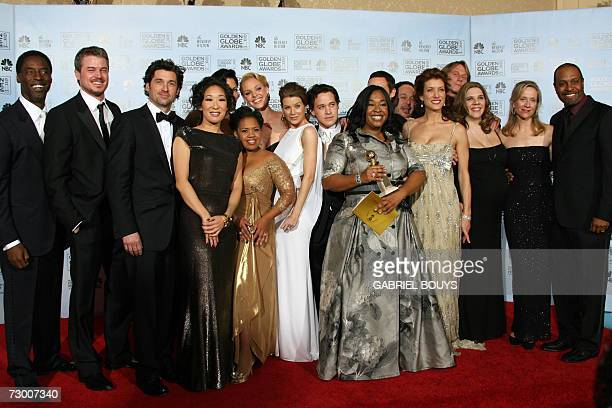 The cast for Grey's Anatomy winner of the Best Television SeriesDrama pose with their award 15 January 2007 at the 64th Annual Golden Globe Awards in...
