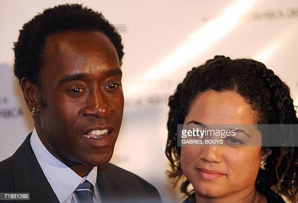 US Actor Don Cheadle and his wife Bridgid Coulter pose at the Regent Beverly Wilshire in Beverly Hills 18 September 2006 as they arrive to...