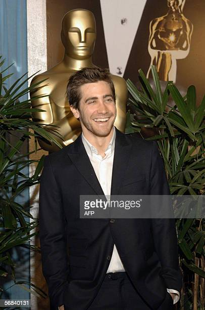 US actor Jake Gyllenhaal nominated for Best Actor in a Supporting Role for Brokeback Mountain poses for photographers as he arrives for the Oscar...