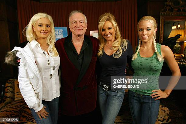 US Playboy Magazine publisher Hugh Hefner poses with his three girl friends Holly Madison 26 Bridget Marquardt 32 and Kendra Wilkinson during a press...