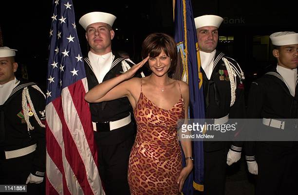 Beverly HillsCalifornia Catherine Bell who stars on CBS's toprated military action television drama JAG salutes photographer while standing next to...