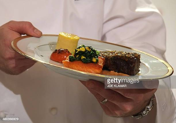 Beverly Hilton's Executive Sous Chef Chris O'Connell works on Mediterranean Spice Crusted Braised Beef Short Rib and Sauteed Smoked Filet of Atlantic...