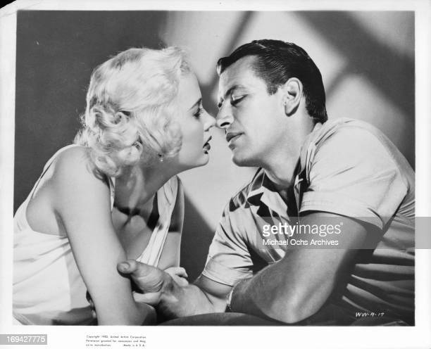 Beverly Michaels and Richard Egan about to kiss in publicity portrait for the film 'Wicked Woman' 1953