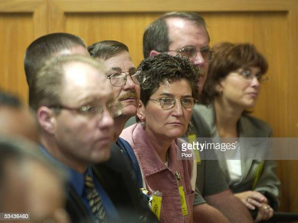 Beverly Plapp whose sister Nancy Fox became along with 9 others a victim of BTK killings looks over a Dennis Rader as he makes a final statement...
