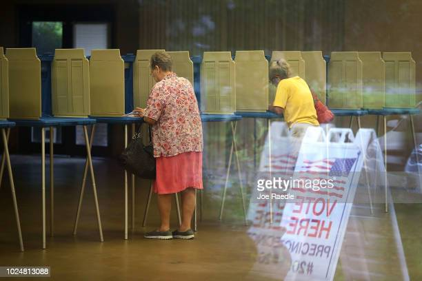 Beverly Putzke fills out her primary day voting ballot at a polling station on August 28 2018 in St Augustine Florida Republican Gov Rick Scott is...