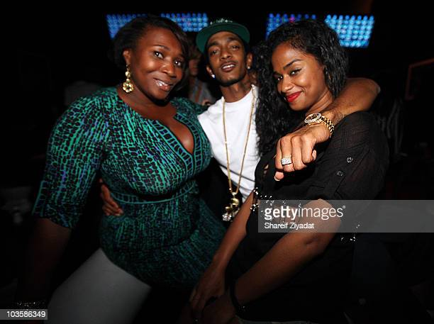Beverly Smith Nipsey Hussle and Vashtie Kola attend the YRB Magazine Art Issue Release Party at Lucky Strike on August 23 2010 in New York City