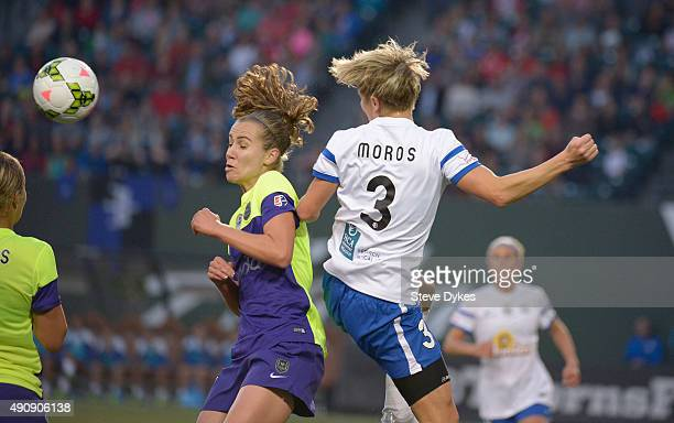 Beverly Yanez of Seattle Reign FC and Rebecca Moros of FC Kansas City go up for a ball during the first half of the game at Providence Park on...