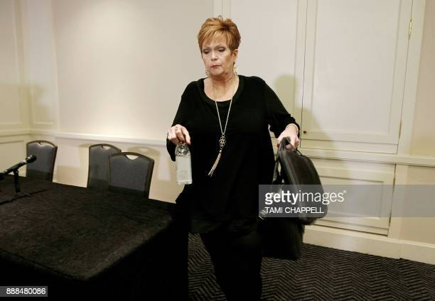 Beverly Young Nelson leaves a news conference after presenting evidence that Alabama US Senate candidate Roy Moore signed her yearbook on December 08...