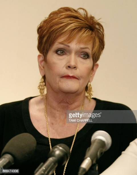 Beverly Young Nelson listens to attorney Gloria Allred at a news conference where she presents evidence that Alabama US Senate candidate Roy Moore...