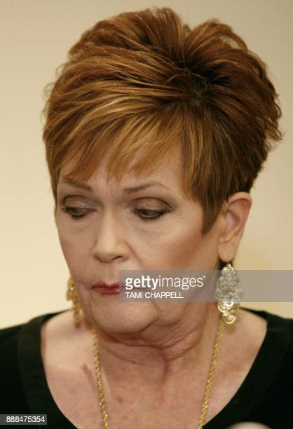 Beverly Young Nelson looks down as she listens to attorney Gloria Allred during a news conference on December 08 2017 in Atlanta Beverly Young Nelson...