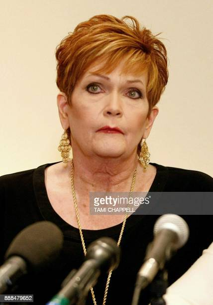 Beverly Young Nelson looks on as she listens to attorney Gloria Allred during a news conference on December 08 2017 in Atlanta Beverly Young Nelson...