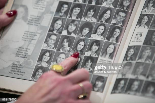 Beverly Young Nelson points to a photo of Roy Moore's wife Kayla in a 1977 yearbook signed by Alabama Senate candidate Roy Moore during a press...