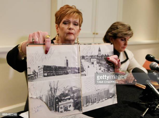 Beverly Young Nelson presents evidence at a news conference that Alabama US Senate candidate Roy Moore signed her yearbook on December 08 2017 in...