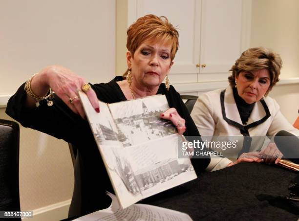 Beverly Young Nelson shows where Alabama US Senate candidate Roy Moore signed her yearbook as her lawyer Gloria Allred looks on during a news...