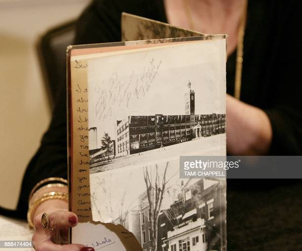 Beverly Young Nelson shows where Alabama US Senate candidate Roy Moore signed her yearbook during a news conference on December 08 2017 in Atlanta...