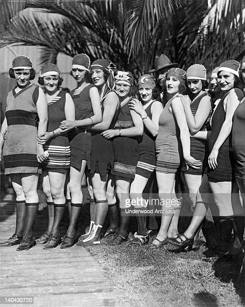 A bevy of flappers in their bathing suits and hats lineup for the camera Los Angeles California circa 1924