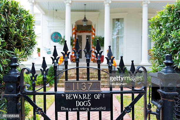 Beware of Dog joke sign on traditional grand mansion house in the Garden District of New Orleans Louisiana USA