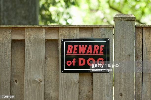 ?beware of dog? sign on wooden fence - warning sign stock pictures, royalty-free photos & images