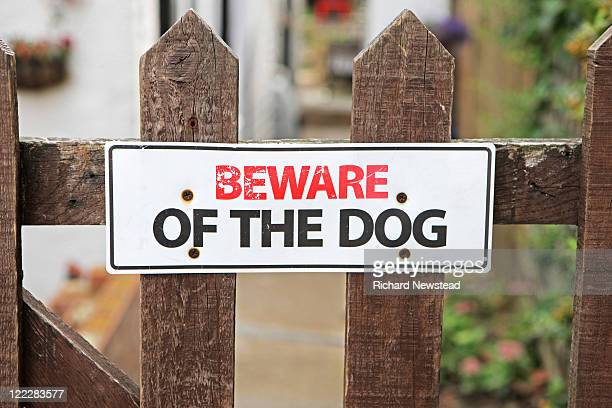 Beware of the dog sign on fence